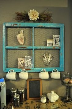 old windows with chicken wire..could add the hooks all around it to hold more coffee mugs