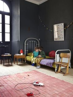 Dark grey walls, pink rug and yellow bedding in children's room of the home of French photographer and stylist Aurélie Lécuyer. Kids Bedroom, Bedroom Decor, Kids Rooms, Design Bedroom, Bedroom Bed, Master Bedroom, Casa Kids, Kids Decor, Home Decor