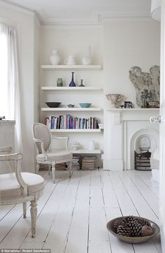 Contemporary shelving in room with bare painted floorboards London townhouse England UK. Painted Wooden Floors, White Painted Floors, Painted Floorboards, White Floorboards, White Wooden Floor, White Flooring, White Washed Floors, Wooden Flooring, Living Room White