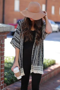 Black and cream patterned kimono with lace trimming looks great with a Fall hat! Catch My Drift Kimono