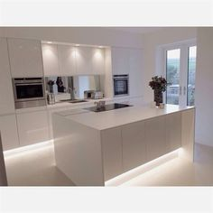 minimal kitchen design Ideas. Modern white gloss integrated handle kitchen with 18mm Corian wrap and worktops. Design by HollyAnna. ALL WHITE! Source: https://i.pinimg.com/originals/6f/22/35/6f22354984df51a76947ae34ad8ccc21.jpg