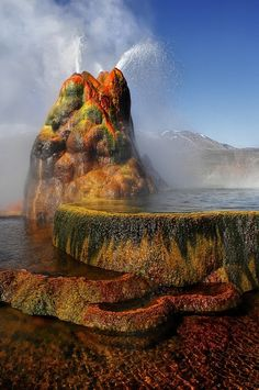 Le Fly Geyser  Photo...Fly Geyser is located on the private Fly Ranch in Hualapai Flat, about 0.3 miles (0.48 km) from State Route 34.[1] The ranch is currently owned by Todd Jaksick.[2] There is a high fence and a locked gate topped with spikes to exclude trespassers. The only access is a dirt road, but it is large enough to be seen from the road