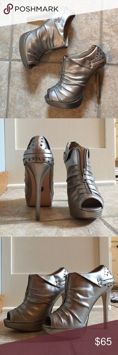"""Pewter peep toe booties by Rock Republic Worn twice! Great condition. Minor scuffing on back of heel but not noticeable while wearing! Super sexy studs and mimicking flap over details with scrunched up front and working zippers. Comfy too! Platform of 1"""" and 5"""" heels gives your bootie a nice boost and the height you crave.  Any shoe lover will fall head over heels for these. Man made materials. Looks like leather. Rock & Republic Shoes Heels"""