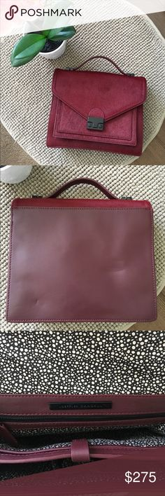 Loeffler Randall Bag Maroon medium rider. Calf hair and leather. Top handle with adjustable shoulder strap. 9.75'L 3.75'D 8'H. Small markings on back from storage.  No Trades. 💜Love the item but not the price? Make an offer.  Happy Shopping 🛍 Loeffler Randall Bags Shoulder Bags