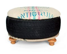 Foot Stool ottoman from saved landfill tire padded top with coffee sack and turned stool feet. $260.00, via Etsy.