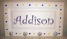 Cabinet door embellished in vinyl with polka dot whimsical knobs on bottom.