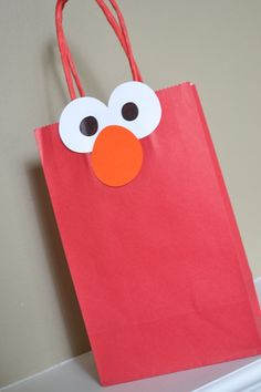 For footloose party, but instead of Elmo and red, use a blue bag with a different shoe at the top for each bag.