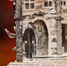 Man outside book page sculpture