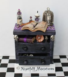 A dollhouse miniature spooky magic bedside drawer for a witch or spooky house in… Halloween Shadow Box, Gothic Halloween, Halloween Doll, Halloween House, Haunted Dollhouse, Haunted Dolls, Dollhouse Miniatures, Spooky House, Witch House