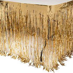 The Gold Metallic Table Skirting are a fantastic way to dress up your tables for your party. Each Gold Metallic Table Skirting measures 30 inches tall x 14 feet long.