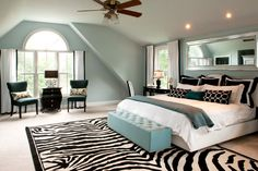 An oversize graphic zebra rug in the master bedroom warms up the large space. Description from houzz.com. I searched for this on bing.com/images