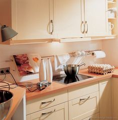 #Kitchen Idea of the Day: Modern Cream-Colored Kitchen (By ALNO, AG) with backsplash storage.