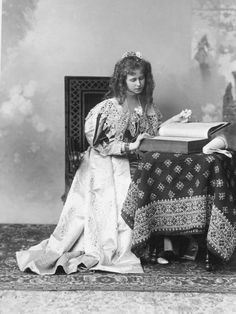 """Princess Maria """"Missy"""" of Edinburgh, later Queen of Romania. Originally black and white photo coloured by me. Princess Missy with a book Romanian Royal Family, Greek Royal Family, Romanian Girls, Princess Alexandra, Princess Margaret, Princess Victoria, Queen Victoria, Maud Of Wales, Spanish Dress"""