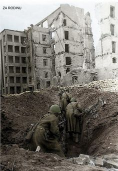 Soviet soldiers finding shelter in a trench within the ruins of Stalingrad 1942