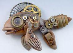 what a CUTE fish! metal. steampunk. copper. brass. wheels. cogs. | RP » ɛïɜ Fishy via The Bouncing Bead ɛïɜ
