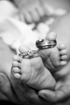Saw other people repinning a pic like this so I had to post mine!!! My sweet little Ainsley's feet! I put the pic up in our house next to our wedding picture.