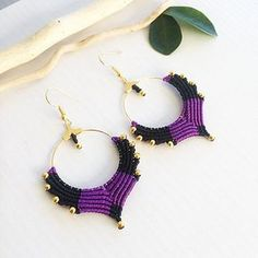 Black and purple macrame earrings. The size is 3 inch with earwire. Materials: black and purple nylon macrame cord 0,8 mm, golden metallic beads 3mm, golden metallic hoop connector, nickel free earwire. my own work and design. bright and elegant earrings are good choice for