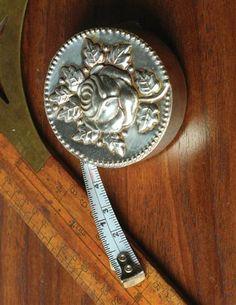 Embossed Rose Measuring Tape.