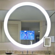 Never miss any of your favorite shows with the Trinity Lighted Mirror TV. This awesome bathroom mirror measures at 42 inches in diameter and it has an ultra bright fluorescent light around the circumference. The hidden Trinity Lighted Mirror TV behind the mirror features a 15.6-inch LED HDTV so you can watch your show, movie, or game as you get ready. #LightedMirrorTV #Trinity http://fancy.to/lrrx9h