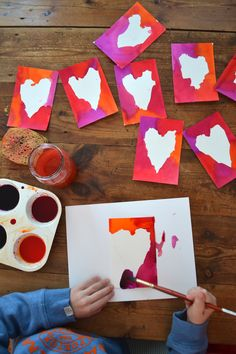kids paint postcards then use newspaper hearts to finish