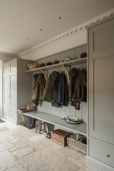 bespoke painted bootroom with fitted cupboards, storage bench and coat hooks by artichoke