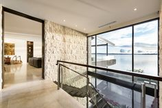 """Combination of natural stone, timber and glass to show off picturesque river views in our """"Natural Balance"""" home"""
