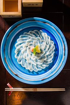 Fugu Sashimi - this is made from the fish, that if the chef does not slice it right, it will kill you!