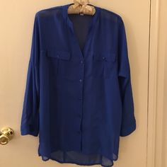 Sheer Candie's blouse Bright blue button-down blouse from Candie's. Sleeves can be worn long or rolled up and buttoned to 3/4 length. Breast pocket on either side. Long enough to tie and wear as a crop or over a cami. Size small Candie's Tops Button Down Shirts
