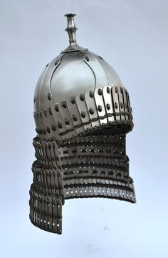 "Tibetan Lamellar Helmet: View - ""Tibetan helmet, of a type used from the – centuries. Helmet skull made of eight plates laced together with leather, with an attached skirt formed from the type of lamellar known as 'willow leaf. Lamellar Armor, Larp Armor, Knight Armor, Warrior Helmet, Ancient Armor, Costume Armour, Armor Clothing, Medieval Weapons, Leather Armor"