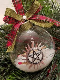 Supernatural ornaments. This is brilliant. With a Castiel angel on ...