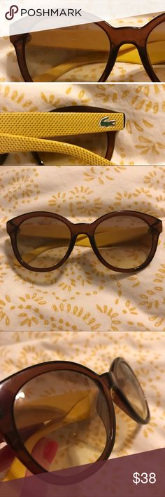 Lacoste sunglasses Love these shades!  Really flattering--the perfect combo of square, round & cat-eye.  One visible scratch just a few mm long as pictured, doesn't affect vision. Lacoste Accessories Sunglasses