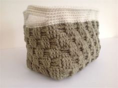 Crochet Basket   Dark Taupe w/ Off White   Comes in your choice of color. If we dont have what your looking for...convo us! We can set up a custom order for you. Orders for this basket is 1 - 3 days.   Measures 5 wide by 7 long and 6 tall.   Made with 4 ply acrylic worsted weight yarns.   Great for House warming gifts,baby showers (can hold baby diapers), home decor, or even an Easter basket center piece for your table.
