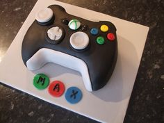 Black And Neon Green Birthday Cake Topped With A Video Game - Video game birthday cake