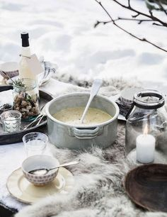 ♔ Picnic in the snow! These are sometimes called Russian Winter Picnics. Use a nice warm blanket as a tablecloth, have food in thick, oven-proof crockery and let it be warming. Don't drink alcohol, but do eat warming foods!