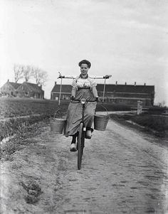 melkmeisje-it must have been difficult peddling a bicycle while wearing wooden shoes and carrying pails full of something!