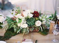 red and green centerpiece - whites and greens with the ruby color.