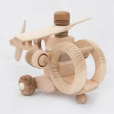 Wood helicopter by DesLineToys on Etsy