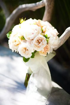 love the peachy tones and ivory tulle bouquet bow wrap