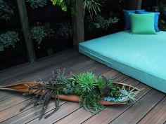 A vertical garden serves as the backdrop for this outdoor lounging area designed by Jamie Durie.