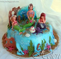 I like how they create the water effect w/ the fondant at the bottom of this cake (it would also be easier than trying to get it smooth).