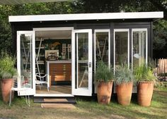 This garden shed doubles as a bookbinder's workshop with full-length windows that allow for the most natural light. Conran Ink