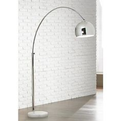 Add a retro feel to your décor with this chic chrome and marble arc floor lamp design from George Kovacs.