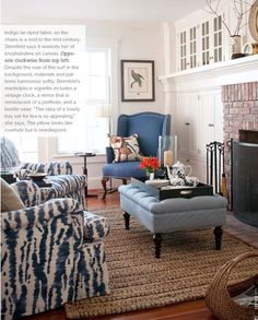 NINE + SIXTEEN: April 2011 / living room - blue accent furniture, sisal jute rug, fireplace, tufted fabric ottoman