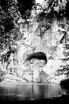 """The Lion Monument (German: Löwendenkmal), or the Lion of Lucerne, is a sculpture in Lucerne, Switzerland, designed by Bertel Thorvaldsen. It commemorates the Swiss Guards who were massacred in 1792 during the French Revolution, when revolutionaries stormed the Tuileries Palace in Paris, France. The American writer Mark Twain (1835–1910) praised the sculpture of a mortally-wounded lion as """"the most mournful and moving piece of stone in the world."""""""