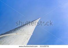 white flagpole against a blue sky