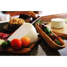 A bountiful #cheeseplatter #feast served on our #teakwood olive serving tray (the thing that looks like a canoe), teak wood cheese paddle, teak wood cutting board w/ strap, and acacia wood baguette tray w/ 3 dipping bowls tag us in your photos so we can see how you use our wood products! #pacificmerchants #PMTC #cheese #olives #nuts #simplepleasures #entertaining #nofilter #foodporn #acaciaware #wood #dishes #PMTCTable #salami #f52grams