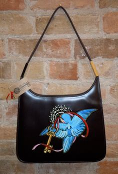 beautiful hand painted blue bird with ribbon and key, and heart shaped lock, brown pleather purse