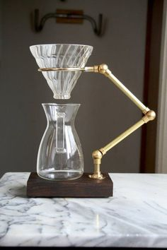 The Curator V60 Pour Over Stand. Glass, brass, and wood.
