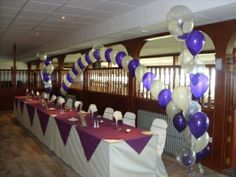 Purple and ivory top table arch