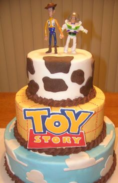 Toy Story Cake made with fondant and buttercream.  Logo is colorflow, bought toy story cake topper.  Unfortunately, no time to make the figures! :-(